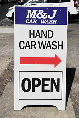 M and J Hand Car Wash sandwich board